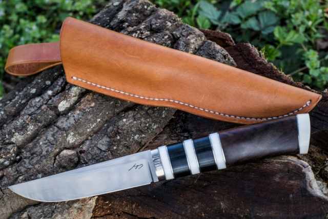 Classic hunting knife with RWL 34 blade. Stabilised walnut handle with corian spacers.