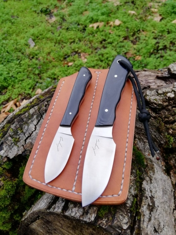 Two small EDC knives made of RWL 34 steel. They both fit in a slim double pocket sheath.