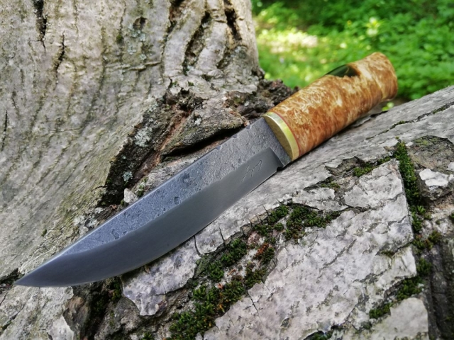 Hunting knife, forged from a silversteel (K5190) round bar. Stabilised alder burl handle.