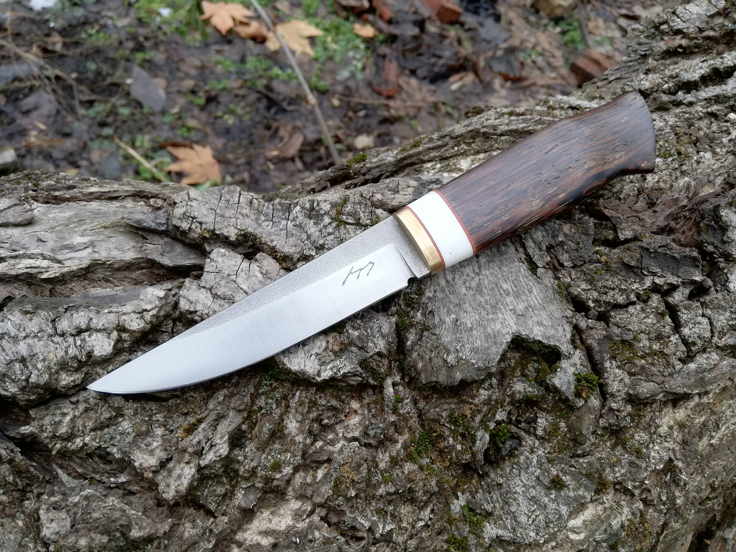 Classical hunting knife, made of 1.2379 steel, venge handle.